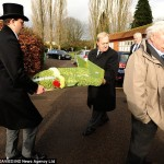Shane Rimmer looks Gerry's floral tributes are moved at Reading Crematorium